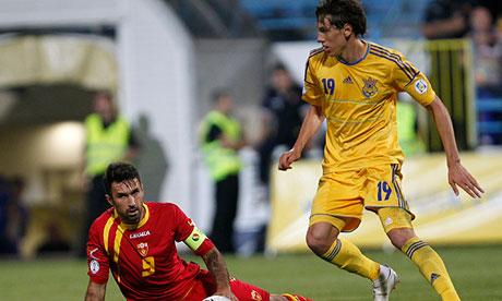 Denys Gamesh, left, challenges Mirko Vucinic during Ukraine's victory over Montenegro in Podgorica